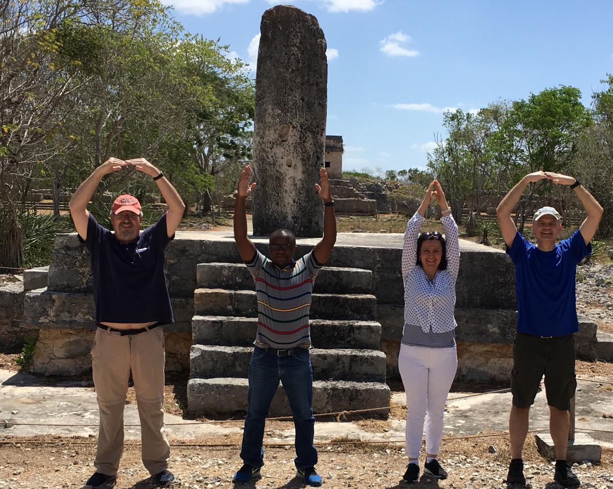 "Dr. Erbaugh, Christopher Lameck, Dr. Rodriguez, and Dr. Scheer, with ""O-H-I-O"" at Mayan Ruins in Merida"